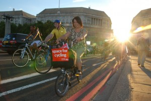 Cyclists on Lambeth bridge with Space for Cycling sign